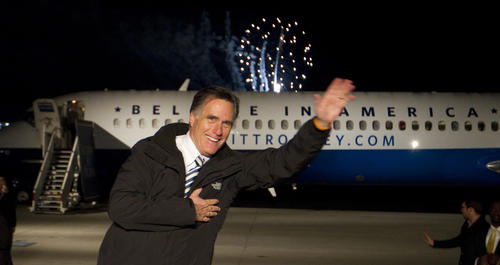 Mitt Romney waves one last goodbye to supporters in Newport News before hopping on his plane to leave as fireworks fly overhead at Newport News Williamsburg International Airport Sunday night.