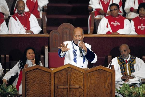 "Pastor J. Edgar Boyd preaches to the congregation as he makes his debut at First AME church in Los Angeles. ""Holding grudges cripples the soul,"" Boyd said. ""It makes you weak... The time has come to cleanse us and welcome us in the favors of God."""