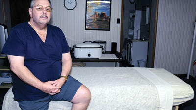 Rick Roth, Davidsville, in his massage room at his home business, Out of Sight Therapeutic Massage.