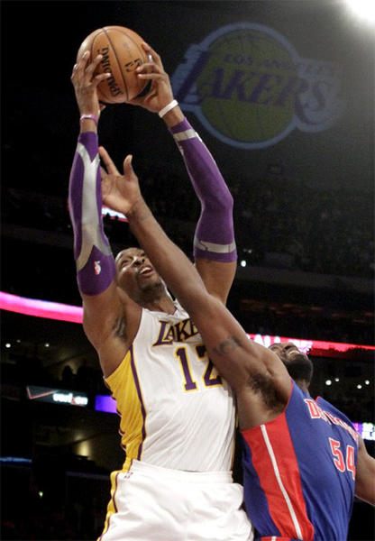 Dwight Howard skies over Detroit's Jason Maxiell for a rebound during the recent Lakers-Pistons game at Staples Center.