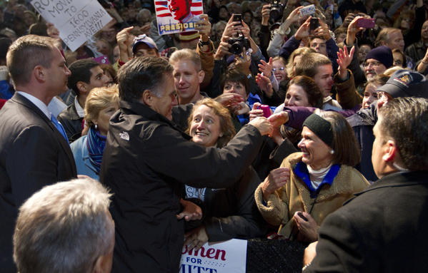 Mitt Romney gets up close with supporters as Bonnie Fick of Elizabeth City, North Carolina (center) and Dabney Shackleford (right) of Richmond, show their support for who they hope will be the next president of the United States after Tuesday's election.