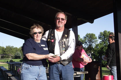 The Spirit Riders Motorcycle Club held a Bow Wow Boogie benefit ride on Sept. 8 for the Aberdeen Humane Society. Presenting a check for $445 to Nancy Upton, left, of the Aberdeen Humane Society is Rich Grote of the Spirit Riders.