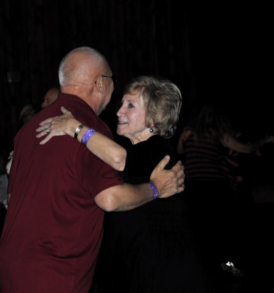 A couple takes advantage of the opportunity to hold each other close, dancing to traditional polka music.