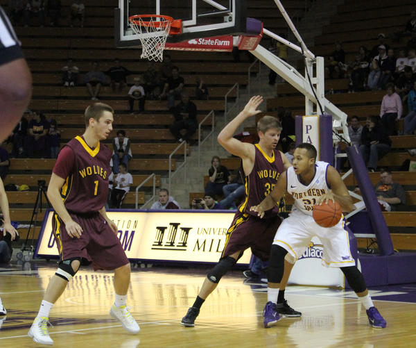 Northern State¿s Mitch White (1) and Dustin Tetzlaff (35) plays defense against Northern Iowa¿s Chris Olivier, right, on Sunday during an exhibition game in Cedar Falls, Iowa. 5UNI Athletics Communications Photo by Mary Howell