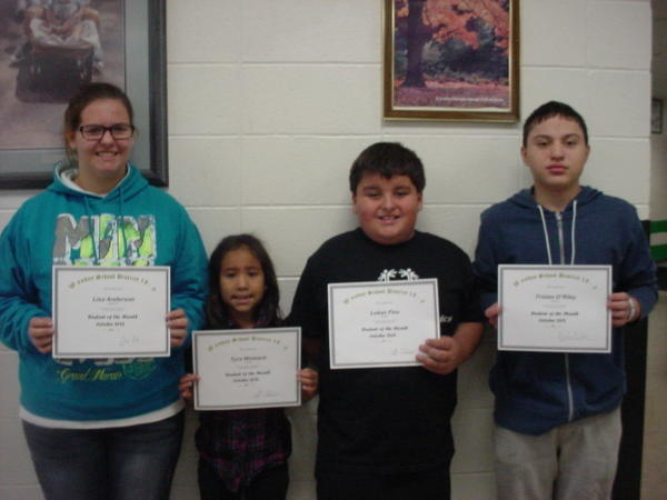 From left, Lisa Anderson, Tyra Womack, Lukas Pies and Tristan O¿Riley were chosen as the October students of the month at Waubay School. Lisa is a sophomore and was chosen for her volleyball accomplishments. Tyra, a first-grader, was selected for being a hard worker. A positive attitude from Lukas garnered his nomination. Tristan, a freshman, represented the school in the All-State Chorus.