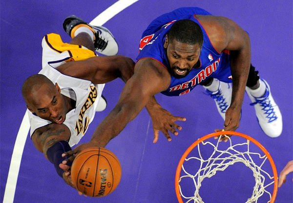 Kobe Bryant drives to the basket as Detroit's Jason Maxiell defends during a game earlier this season.