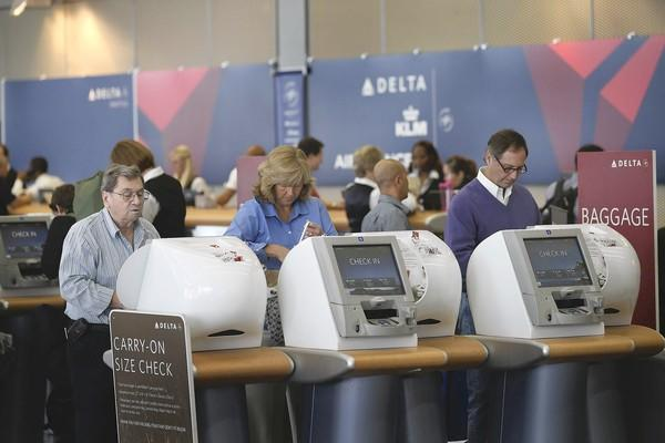 The world's biggest airlines are expected to collect $36.1 billion in passenger fees in 2012, according to a study released by IdeaWorksCompany. That's up 11.3% from the estimate for 2011. Above, passengers check in at Delta Air Lines last month at O'Hare International Airport in Chicago.