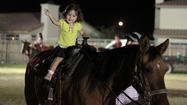 Laughter, smiles and the aroma of sweets filled T.L. Waggoner Elementary School in Imperial on Saturday evening, as the community came together for the Western Round-Up School Carnival.