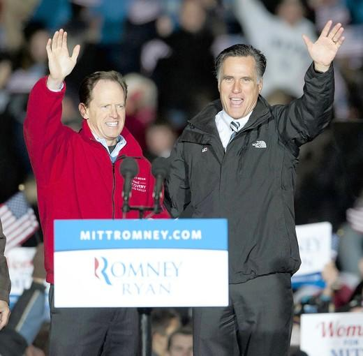 Republican presidential hopeful Mitt Romney (right) waves to the crowd along with U.S. Sen. Pat Toomey at a rally in Yardley on Sunday.