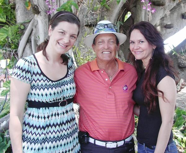 Publisher and golf legend Chi Chi Rodriguez poses with Liberty High School graduate Marisa de Jesus Paolicelli, author of Lightkeepers to the Rescue (right) and illustrator Tanja Bauerle, who did the artwork for Paolicelli's first book.