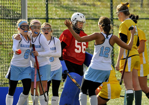 Garrison Forest teammates congratulate No. 6 Erica Marshall, left, who scored the second goal unassisted in the second half, as Bryn Mawr goalkeeper No. 56 Claire Edelman looks down.