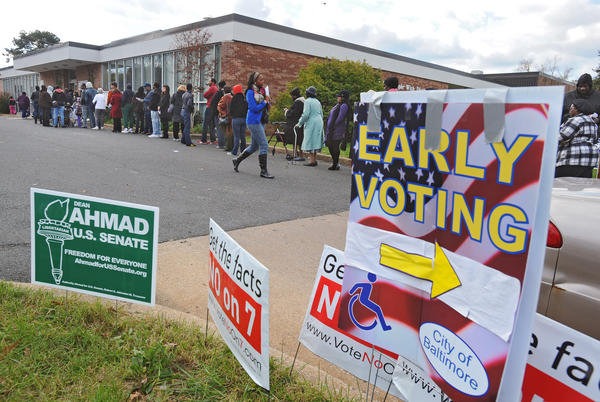 Baltimore City residents wait in line to vote at Early Voting site number two at the League for People with Disabilities on East Coldspring Lane during the last day of early voting. There were about 200 people in lines inside the building waiting to vote.