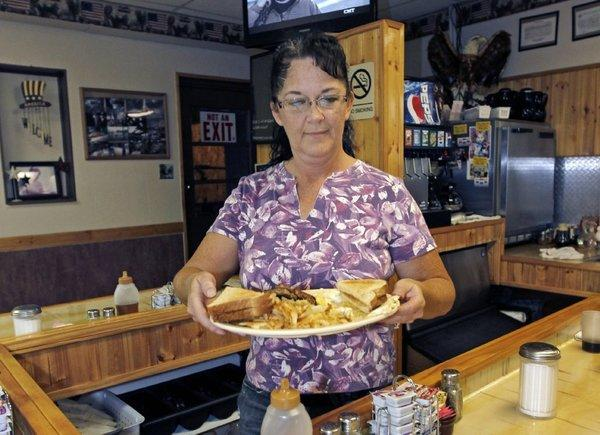 Millie Brown, a cook and waitress at Buch's truck stop, serves a breakfast in Steubenville, Ohio.