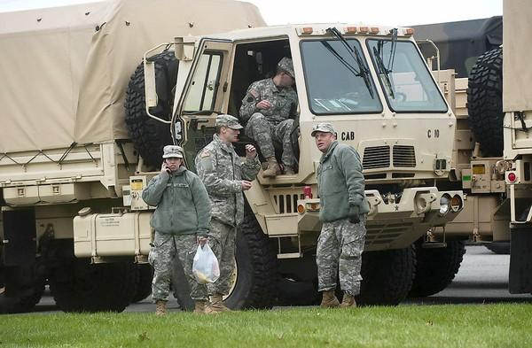 Members of the Forks Township-based unit of the Pennsylvania National Guard prepare to depart for New York City Sunday to help in post-Sandy relief and cleanup efforts.