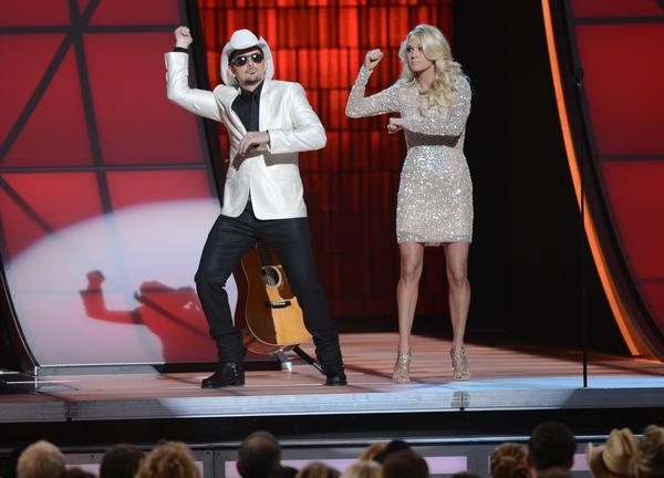 Hosts Brad Paisley and Carrie Underwood do a little Gangnam-style dance at the CMA Awards.