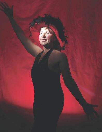 R. Anne Hull, of Laurel, stars as Auntie Mame in Laurel Mill Playhouse's current show.