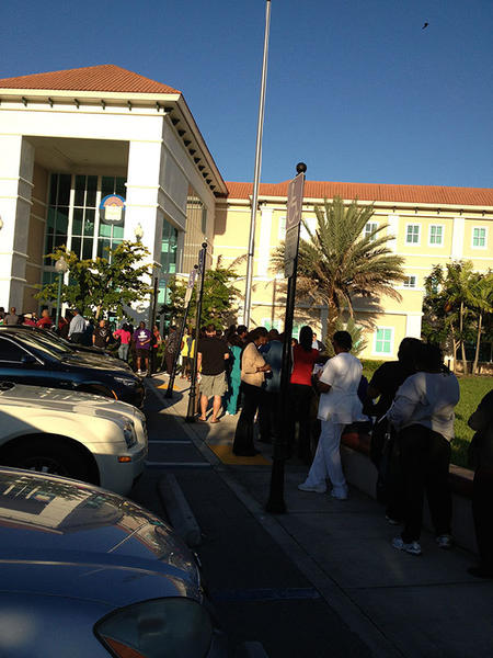 Fl-early-voting-update  Hundreds of people stand in line at the Miramar branch library to cast their votes. The wait is about two and a half hours.
