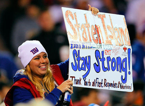 A fan of the New York Giants holds up a sign thanking first responders in the Staten Island borough of New York City that was ravaged during Superstorm Sandy as she watches the Giants play the Pittsburgh Steelers in the fourth quarter during an NFL game at MetLife Stadium on November 4, 2012 in East Rutherford, New Jersey. The Steelers defeated the Giants 24-20.