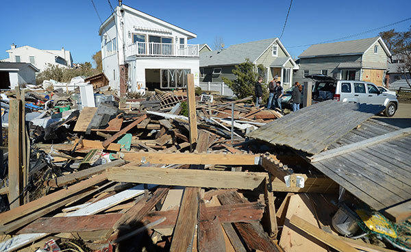 Photo shows the devastation in Lindenhurst, New York in the aftermath of Superstorm Sandy on Sunday, November 4, 2012.