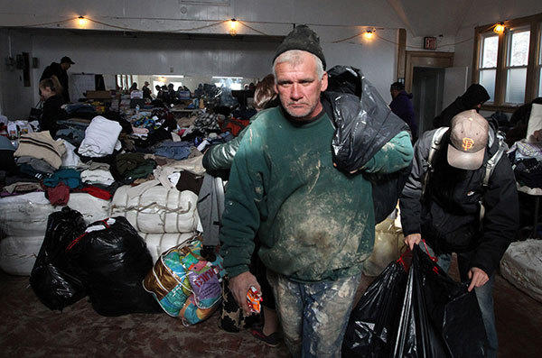 William Heins, of the Sea Gate neighborhood of Coney Island, New York, collects donated clothing on November 4, 2012.