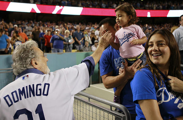 "Opera star Placido Domingo greets a young Dodgers fan as he leaves the field after singing ""God Bless America"" and ""Take Me Out to the Ball Game"" during the seventh inning stretch at Dodger Stadium. <br><a href=""http://www.latimes.com/entertainment/arts/culture/la-et-cm-placido-domingo-20121014,0,1054315.story"" target=""blank""><b>More:</b> Plácido Domingo leads an uptempo life</a>"