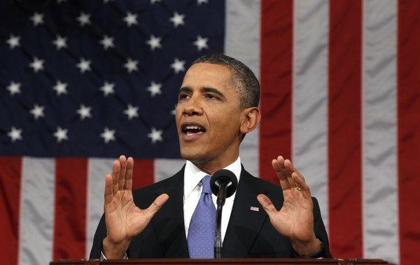 President Obama is seen delivering a speech to a joint session of Congress at the Capitol in Washington D.C.