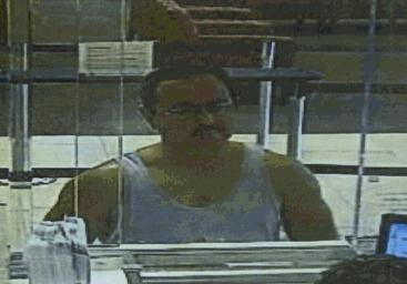 Police release surveillance photo of man cashing counterfeit check at a Wells Fargo