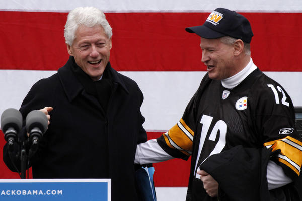 Rep. Mark Critz (D-Pa.), sporting a Terry Bradshaw Steelers jersey, introduces former President Clinton at a rally to get out the vote for President Obama in downtown Pittsburgh.
