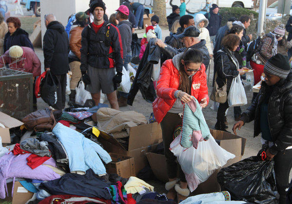 Residents of the Sea Gate community in Coney Island, New York, sift through donated clothing.