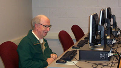 George S. Cook is pictured in the computer lab at Allegany College of Maryland, Somerset campus. The late businessman is credited for greatly helping the college.