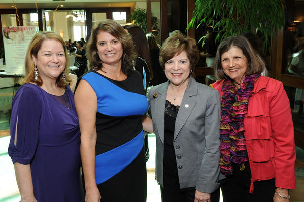 "Sarah Franco, left, Laurie Rich Levinson, Sen. Nan Rich and Dale Sanders at JAFCO's ""Spirit of Life Luncheon,"" which took place Oct. 10 at Weston Hills Country Club and raised more than $35,000."