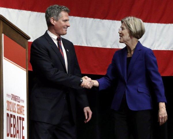 Republican Sen. Scott Brown shakes hands with Democratic challenger Elizabeth Warren prior to a debate in Springfield, Mass., on Oct. 10.