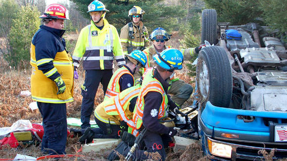 Members of Otsego County Heavy Rescue worked to free a trapped motorist after her vehicle rolled several times Monday afternoon.