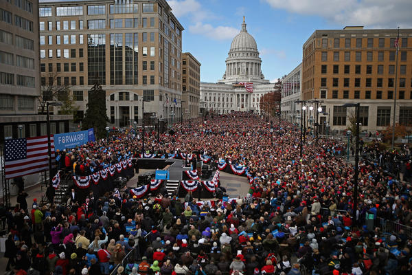 People fill the streets in front of the state Capitol building to hear President Obama address a rally during the last day of campaigning in the general election in Madison, Wis.
