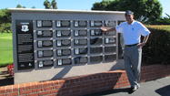 Loren Roberts stands next to his name on the wall of past Toshiba Classic champions who are in the Toshiba Classic Hall of Fame.