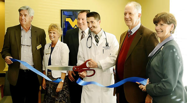 Attending a ceremonial ribbon cutting at WVU Urgent Care in Ranson, W.Va., are, from left, Ranson Mayor David Hamill; Linda Blanc, administrative nursing officer at Jefferson Memorial Hospital; Aaron Henry, vice president of administration for West Virginia University Health Sciences Center Eastern Division; Dr. David Roelkey of WVU Urgent Care; Walter Washington, a member of the West Virginia University Hospitals-East board of directors; and Heather Morgan McIntyre from the Jefferson County Chamber of Commerce.