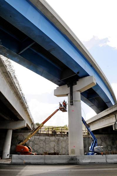 Crews work on support columns of the University Drive flyover to eastbound I-595 in preparation for raising the 5 million pound bridge 18 inches so that it will be in alignment with the new, wider I-595.