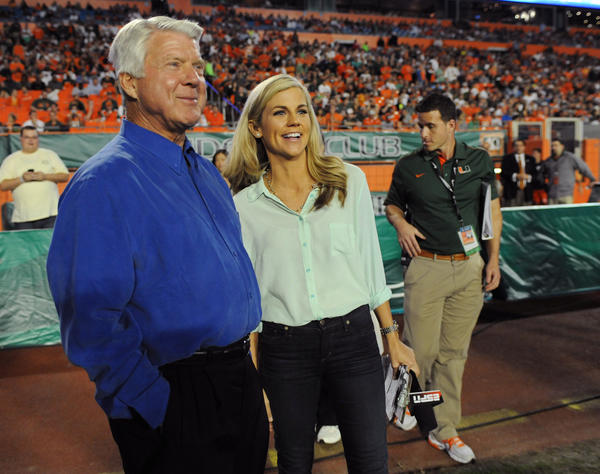 ESPN sideline reporter Samantha Steele hangs out with Jimmy Johnson before a halftime ceremony at the game against Virginia Tech.