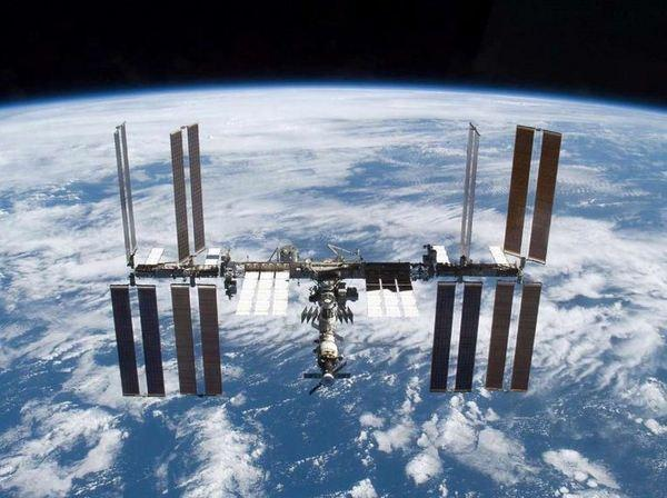 The International Space Station is photographed shortly after the space shuttle Atlantis undocked from it.