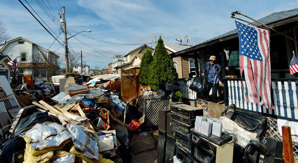 Sal Conte cleans up the damage from the storm surge of Hurricane Sandy in the New Dorp Beach neighborhood of Staten Island, New York.