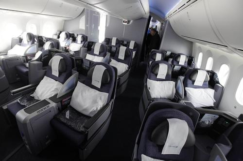 Seats in BusinessFirst recline to a fully flat bed measuring 6 feet, 6 inches.