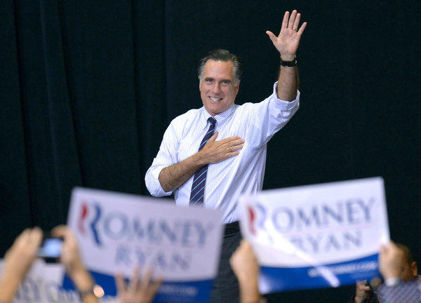 Mitt Romney leads a campaign rally at George Mason University in Fairfax, Va.