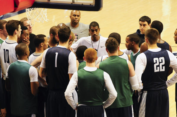 Kevin Ollie and the Huskies gather for a final practice in Storrs before heading to Germany.