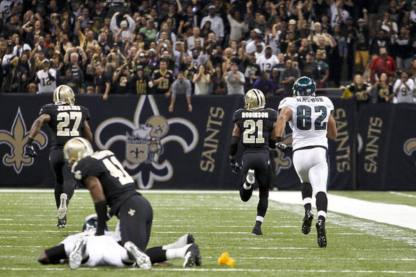 New Orleans Saints cornerback Patrick Robinson (21) returns a Philadelphia Eagles quarterback Michael Vick (7) interception for a touchdown during the first quarter of a game at the Mercedes-Benz Superdome.