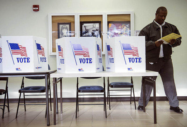 A voter in Lancaster, Ohio, gets up after filling out a paper ballot during the final day of early voting in the state.