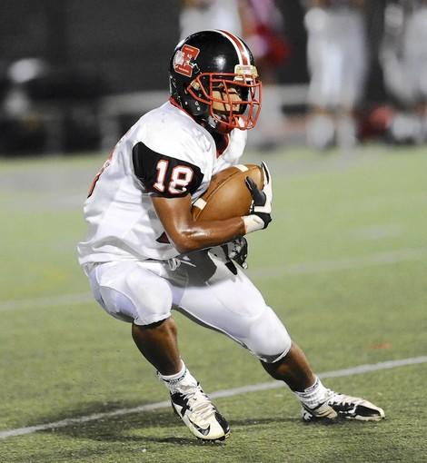 Easton's Shane Simpson had a 42-yard touchdown run in the first half, but left the game with an injury.
