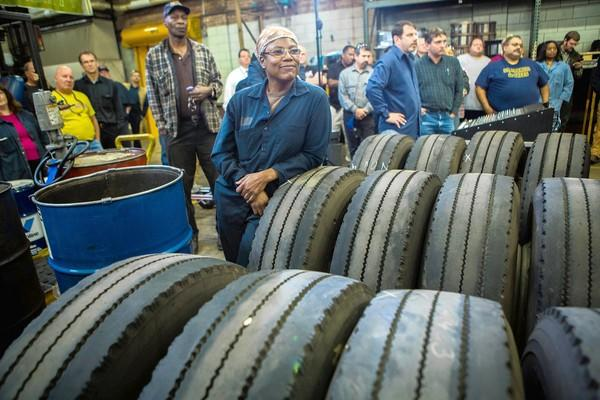 Nina Cravens and other workers listen Monday as Mayor Rahm Emanuel and CTA President Forrest Claypool announce new labor agreements at the CTA maintenance facility in Chicago's West Chatham neighborhood.