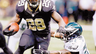 New Orleans Saints running back Chris Ivory (29) carries past Philadelphia Eagles defensive back David Sims (21) on a touchdown run during the first half of an NFL football game at Mercedes-Benz Superdome in New Orleans, Monday.