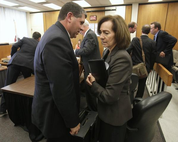 Gary Winuk, an attorney for the state Fair Political Practices Commission, confers with commission chair Ann Revel after a court hearing on the FPPC's lawsuit against a group it accused of concealing the source of $11 million put into California's election.