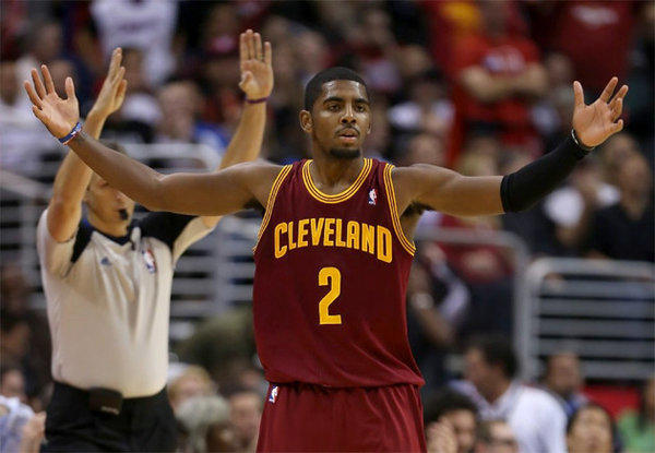 Kyrie Irving celebrates after hitting a three-point shot that sealed a win for Cleveland.